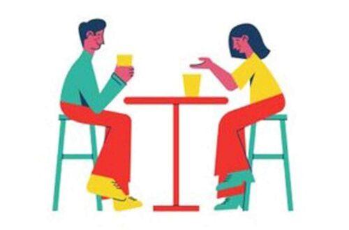 Ein Plakat mit einem Mann und einer Frau, die in einem Café am Tisch sitzen.